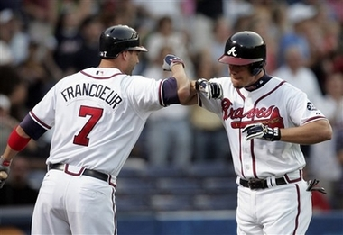 Chipper Jones Home Run Near Dale Murphy Atlanta Record Photo Atlanta Braves' Chipper Jones, right, is congratulated by teammate Jeff Francoeur after hitting a two-run home run against the Philadelphia Phillies in the first inning of a baseball game Tuesday, May 1, 2007, in Atlanta. (AP Photo/Todd Bennett)