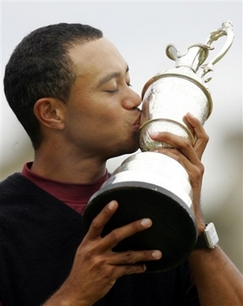 Tiger Woods Dominates the British Open Tiger Woods kisses the trophy after winning the British Open golf championship on the Old Course at St. Andrews, Scotland, in this July 17, 2005 file photo. (AP Photo/Alastair Grant)