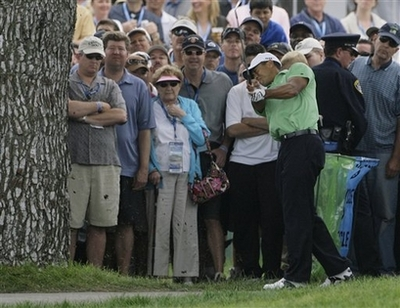 Tiger Woods 2008 U.S. Open Tree Shot Photo Tiger Woods hits from the rough on the first fairway during the second round of the US Open championship at Torrey Pines Golf Course on Friday, June 13, 2008 in San Diego. (AP Photo/Matt Slocum)