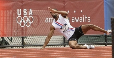 Tyson Gay falls during the first quarterfinal heat of the men\'s 200 meter race at the U.S. Olympic Track and Field Trials in Eugene, Ore., Saturday, July 5, 2008. (AP Photo/David J. Phillip)